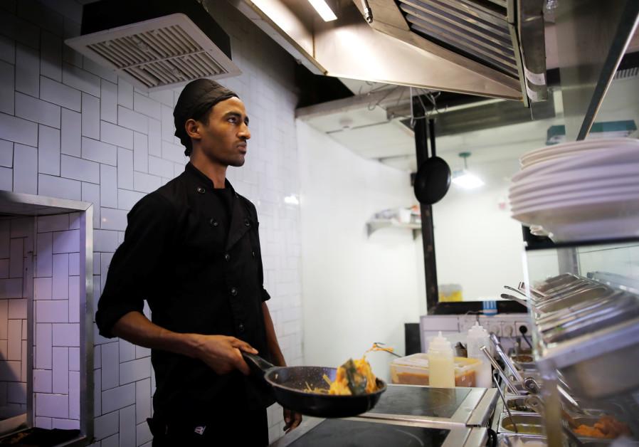 Teklit Michael, 29, an asylum seeker from Eritrea, works in the kitchen of a restaurant in Tel Aviv