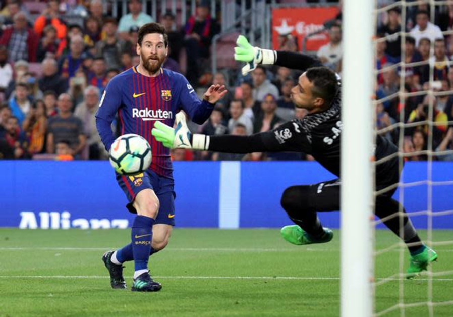 Argentine forward Lionel Messi (L) scores during play for club team F.C. Barcelona, May 9, 2018.