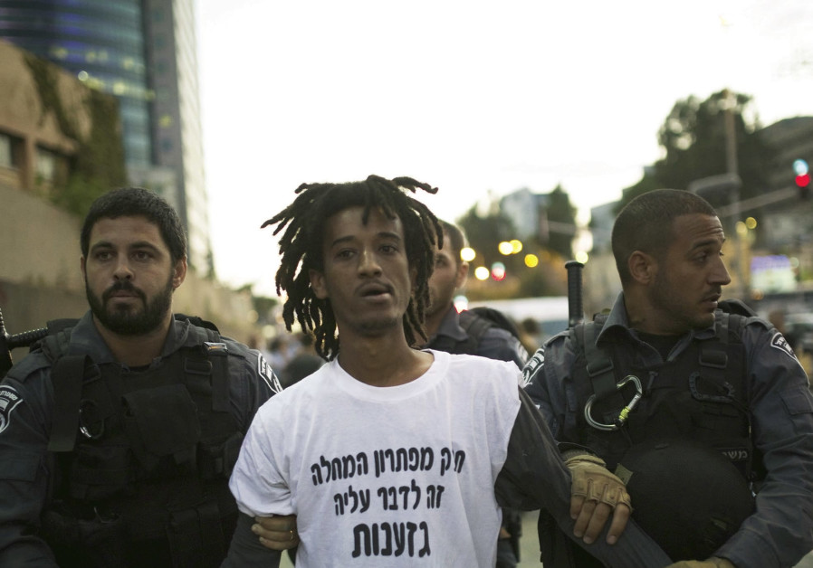 ISRAEL POLICE detain a protester during a 2015 anti-racism demonstration in Tel Aviv.