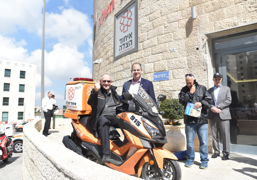 Alan Dershowitz's first ride on a United Hatzalah ambucycle
