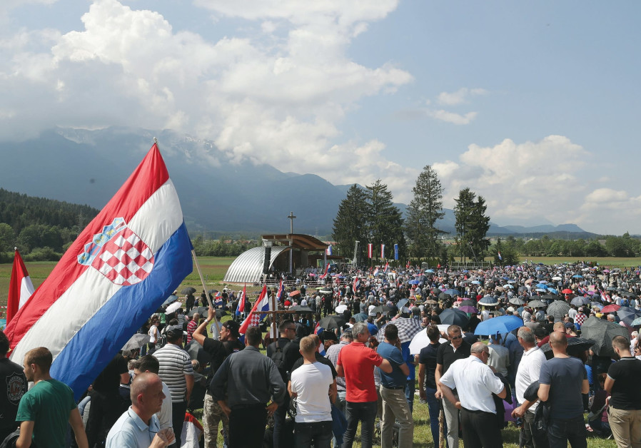 PARTICIPANTS TAKE part in a Catholic ceremony commemorating the turning away from Austria.