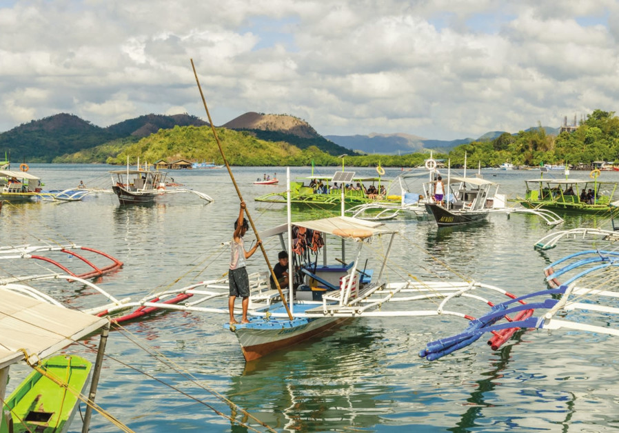 Boats at Coron harbor are for hire to get to various sites on Coron Island, May 27, 2018.