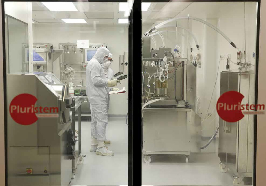 Biologists work in a laboratory at Pluristem Therapeutics Inc. in Haifa