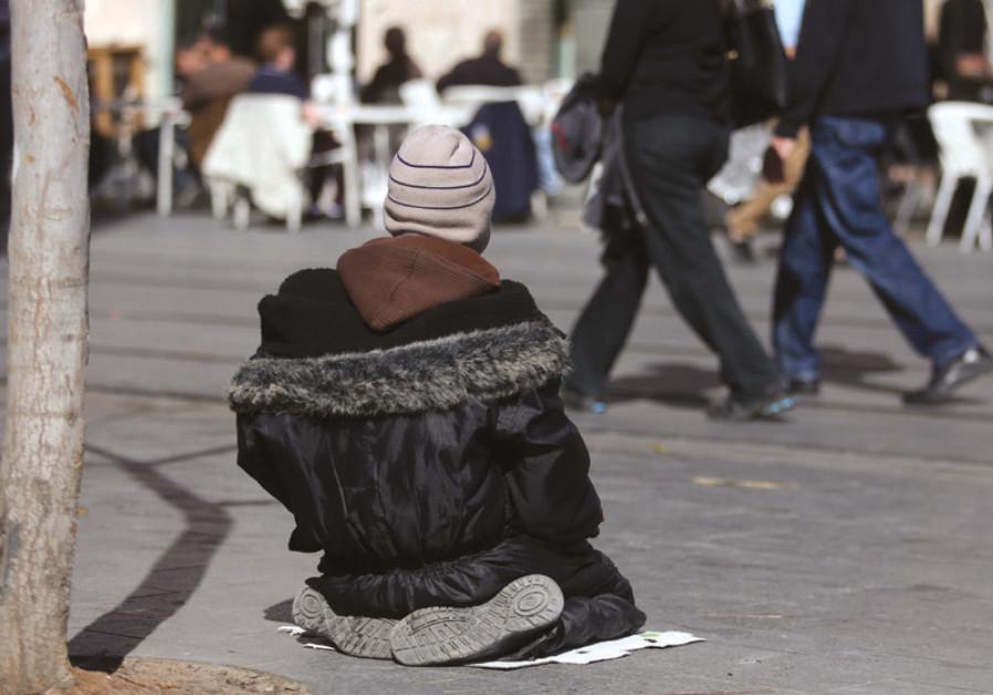 A beggar on Jerusalem's Ben-Yehuda Street