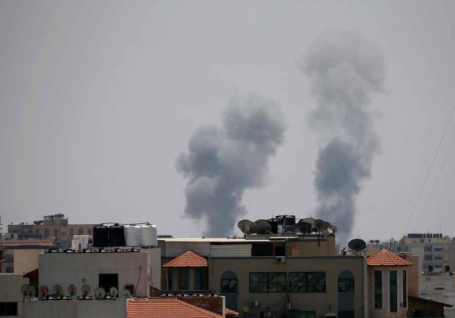 Smoke rises following an Israeli air strike in Gaza May 29, 2018