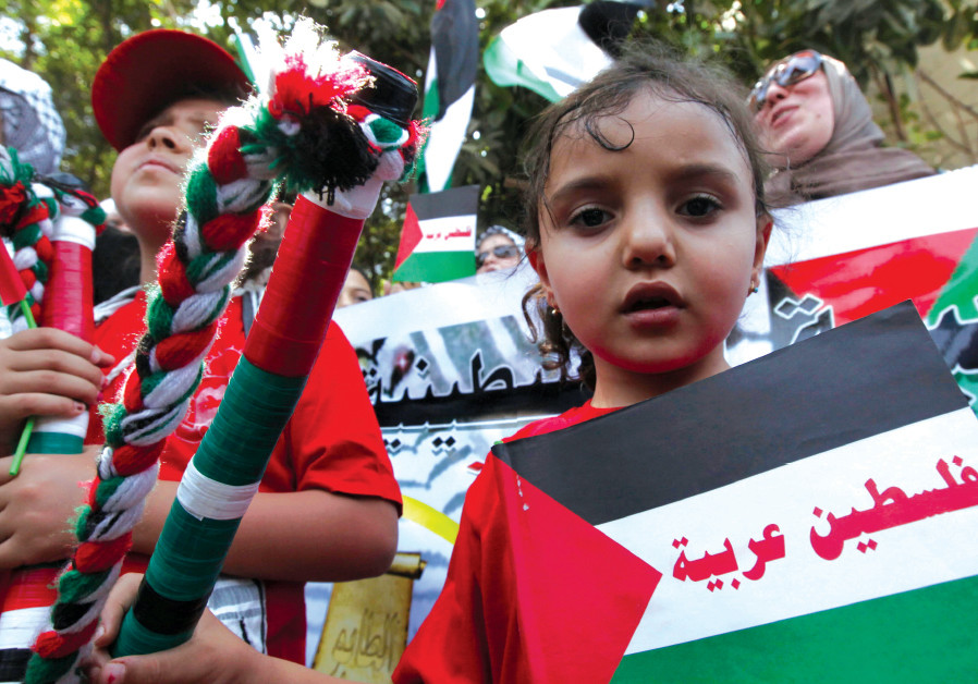 A PALESTINIAN girl living in Egypt participates in a Nakba Day protest against Israel in Cairo in 20