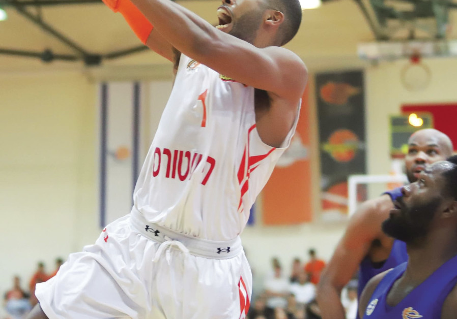 roni Ness Ziona guard Gary Browne scores two of his 10 points in last night's 95-94 win.