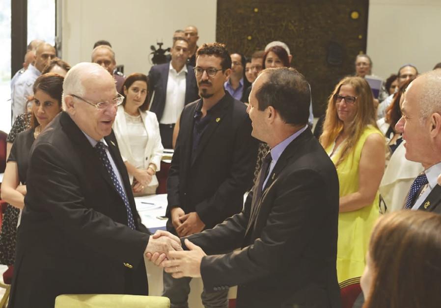 PRESIDENT REUVEN Rivlin (left) shakes hands with Jerusalem Mayor Nir Barkat.
