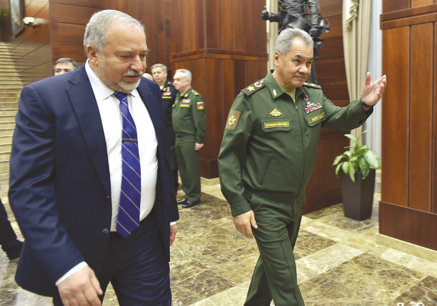DEFENSE MINISTER Avigdor Liberman and his Russian counterpart, Sergei Shoigu, walk to their meeting.