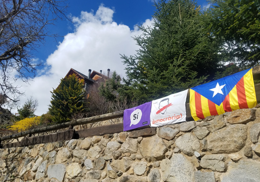 Pro-Catalan independence banners hang from a fence in a small Catalan community in the lower Pyrenees. (Eric Sumner)