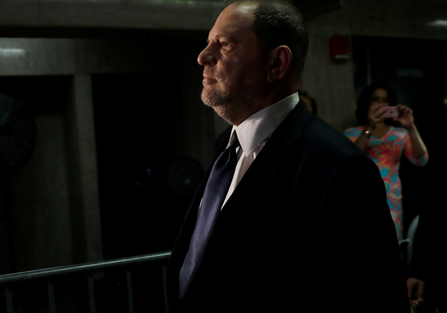 Film producer Harvey Weinstein arrives for his arraignment at Manhattan Criminal Court in New York,