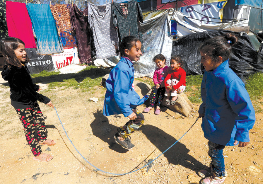 SYRIAN REFUGEE children play at a tented settlement in the town of Qab Elias, in Lebanon's Bekaa Val