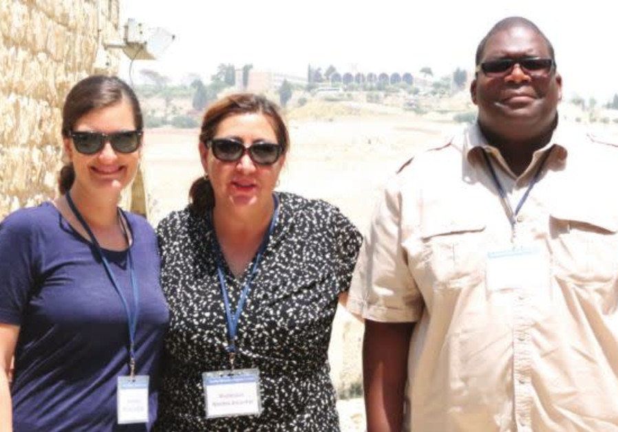 From left to right: Profs. Amalia Leicester, Norma Alcantar and Tyrell Carr pose in Jerusalem's Old