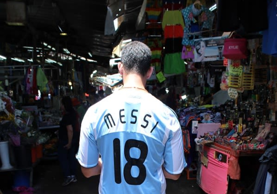 Argentina fan Remy Friedman at the market in Tel Aviv