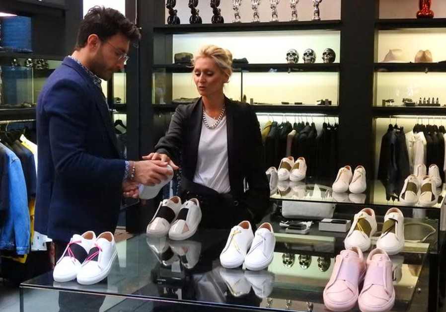 Syrian designer Daniel Essa talks with Emmanuelle Axer, manager of Maison de Mode, as he looks at his luxury sneakers during an interview at a concept store in Lille, France, June 6, 2018. (Credit: Noemie Olive/Reuters)