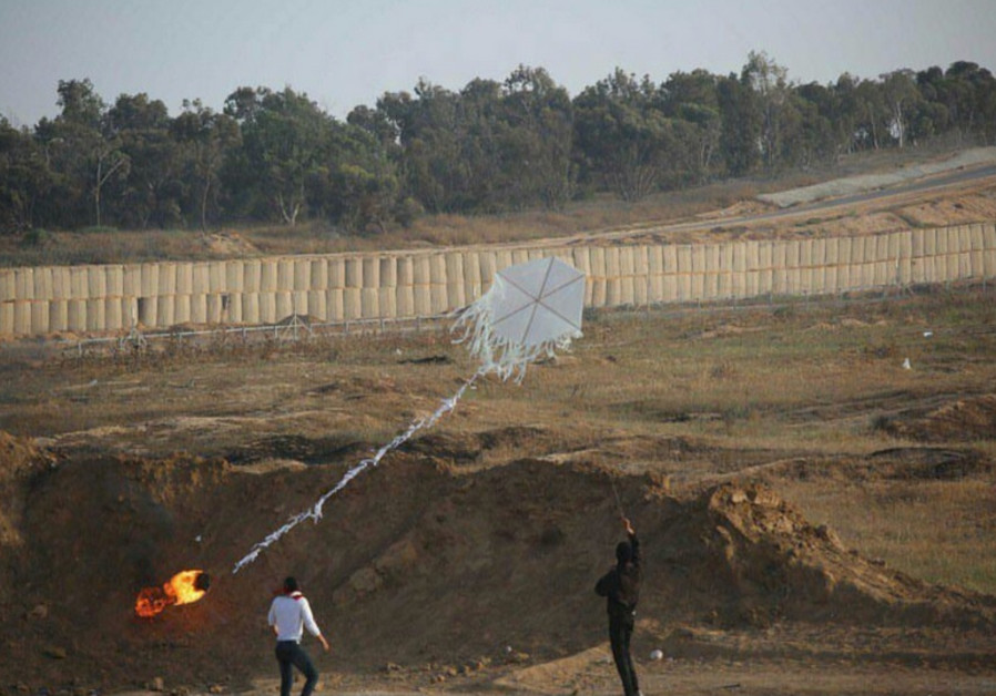 Palestinians in Gaza prepare a kite amid protests at the border fence, June 8, 2018.