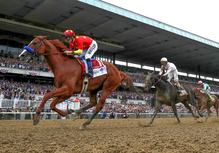 Justify with jockey Mike Smith aboard wins the 150th running of the Belmont Stakes, the third leg of