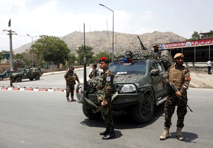 Afghan security forces keep watch at the site of a suicide attack in Kabul Afghanistan