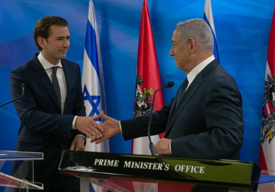 Prime Minister Benjamin Netanyahu (R) shakes hands with Austrian Chancellor Sebastian Kurz (L)