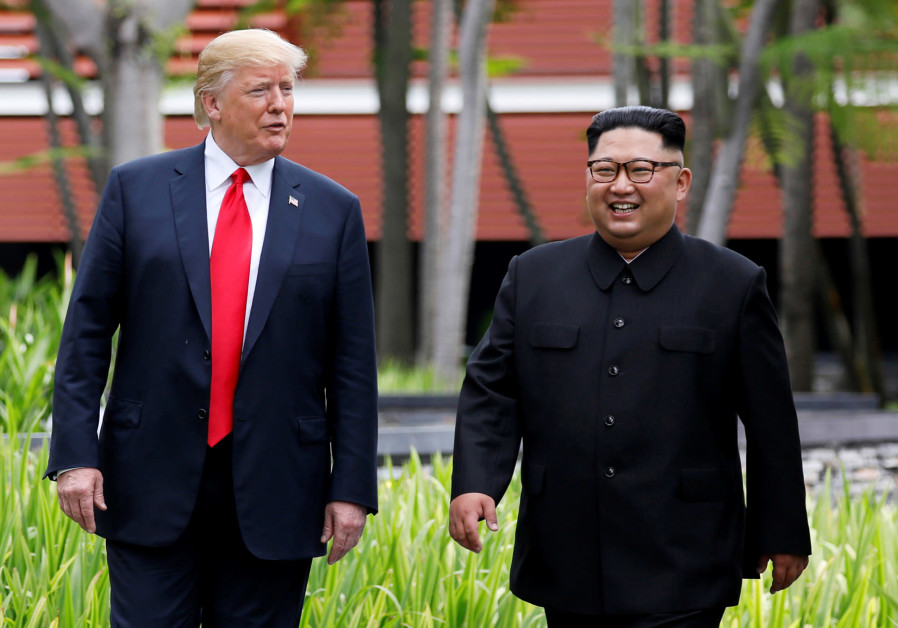 US President Donald Trump and North Korean leader Kim Jong Un walk after lunch at the Capella Hotel