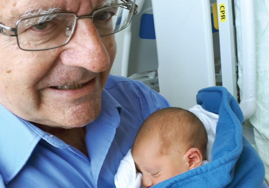 The writer, Shlomo Maital, with his new grandson Carmel Sapir Maital
