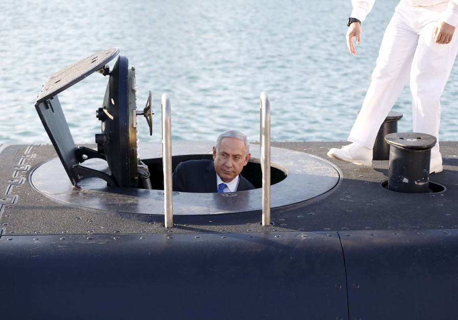 Prime Minister Benjamin Netanyahu climbs out after a visit inside the Rahav, the fifth submarine in