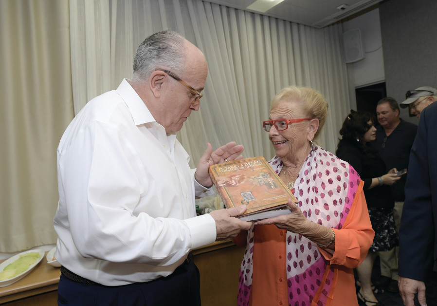 BARBARA GOLDSTEIN presents Rudy Giuliani with a copy of 'It Takes a Dream: The story of Hadassah,'