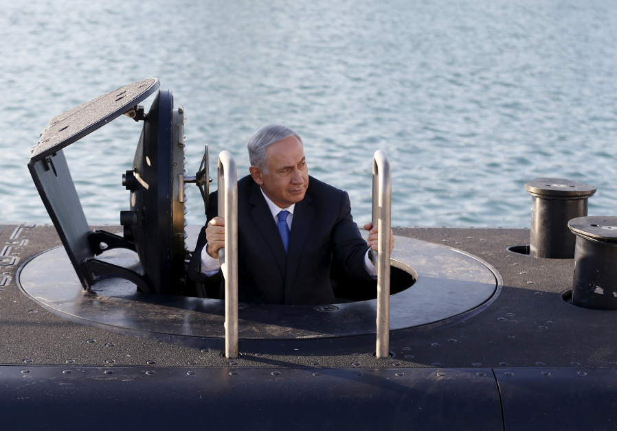 Prime Minister Benjamin Netanyahu climbs out of the 'Rahav,' the fifth submarine in the navy's fleet