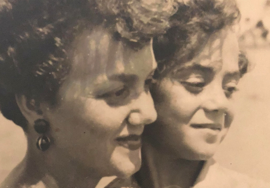 RLETTE SIDES with her daughter in Ras el-Bar, Egypt, in 1953