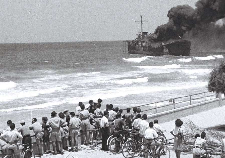 BYSTANDERS WATCH as the 'Altalena' burns after being shelled near Tel Aviv on June 22, 1948