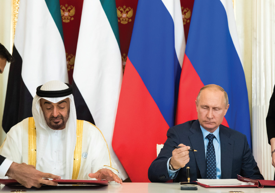 RUSSIAN PRESIDENT Vladimir Putin (seated, right) and Abu Dhabi's Crown Prince Sheikh Mohammed bin Za