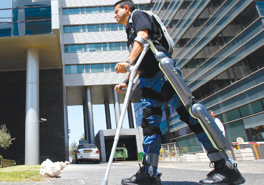A MAN walks using ReWalk, an electronic exoskeleton, at a development center in Haifa