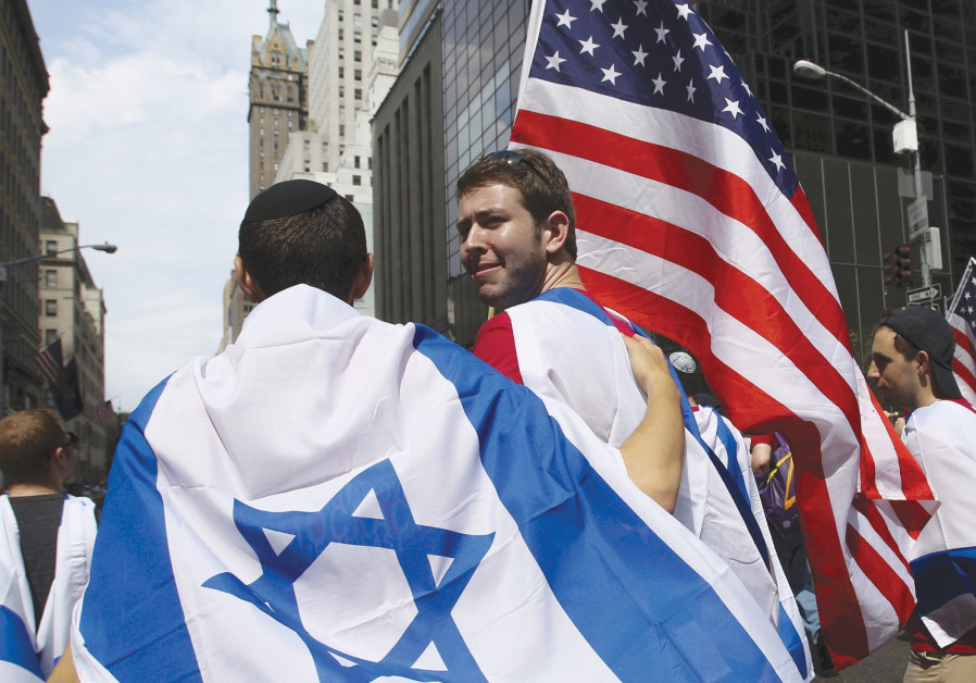 AMERICANS TAKE part in the annual Salute to Israel parade in New York City. Polls show that Israeli
