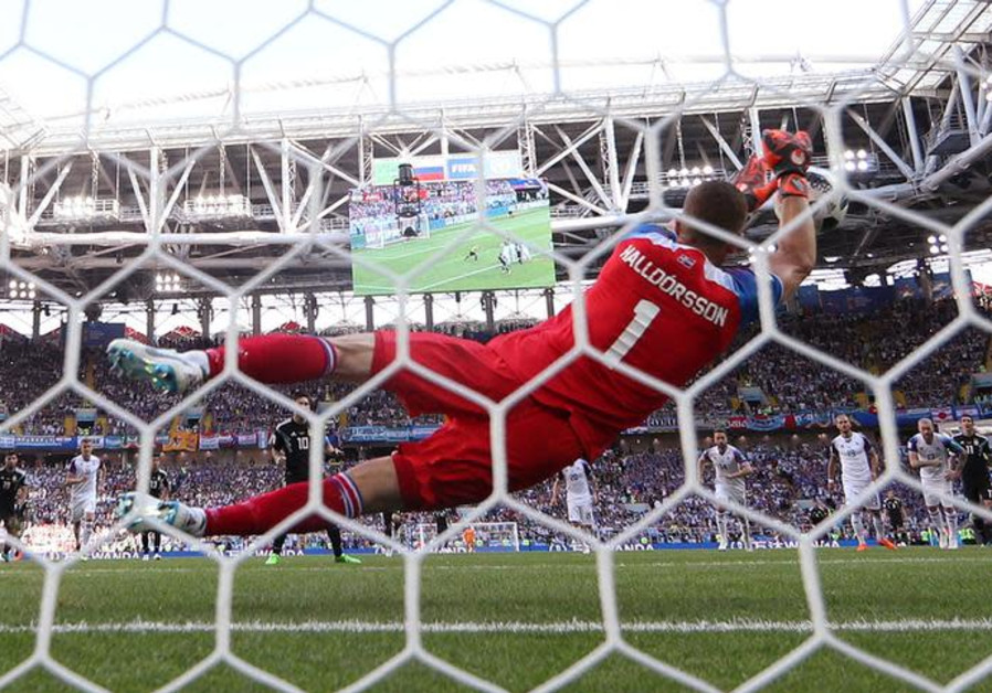 Iceland's Hannes Por Halldorsson saves a penalty from Argentina's Lionel Messi on June 16th, 2018