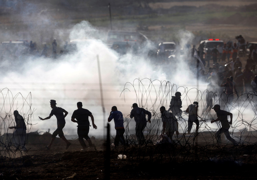 Palestinians protesting on the Gaza side of the border between Israel and Gaza, June 2018