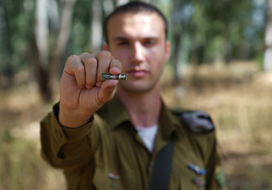 Soldier holding the newly designed pin