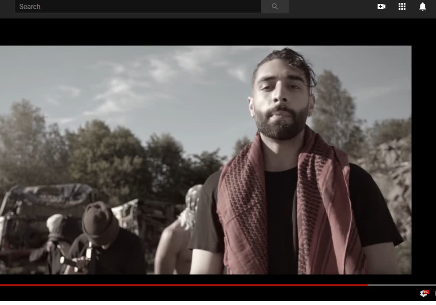 "Kaveh Kholardi in a music video for his song ""The man"""
