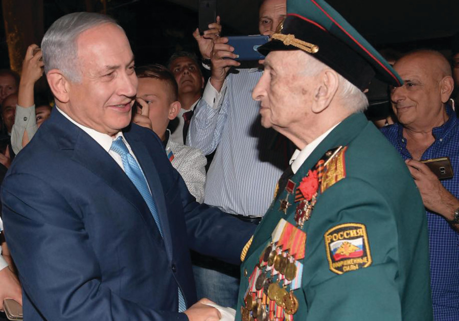 PRIME MINISTER Benjamin Netanyahu greets the bemedaled veteran of the Red Army Emil Zigel on Victory