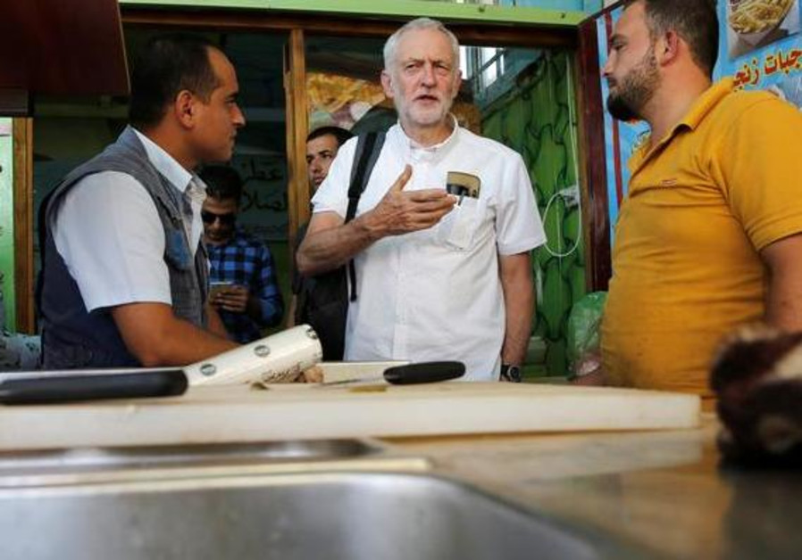 Britain's opposition leader Jeremy Corbyn during his visit to Al Zaatari refugee camp, in the Jordan