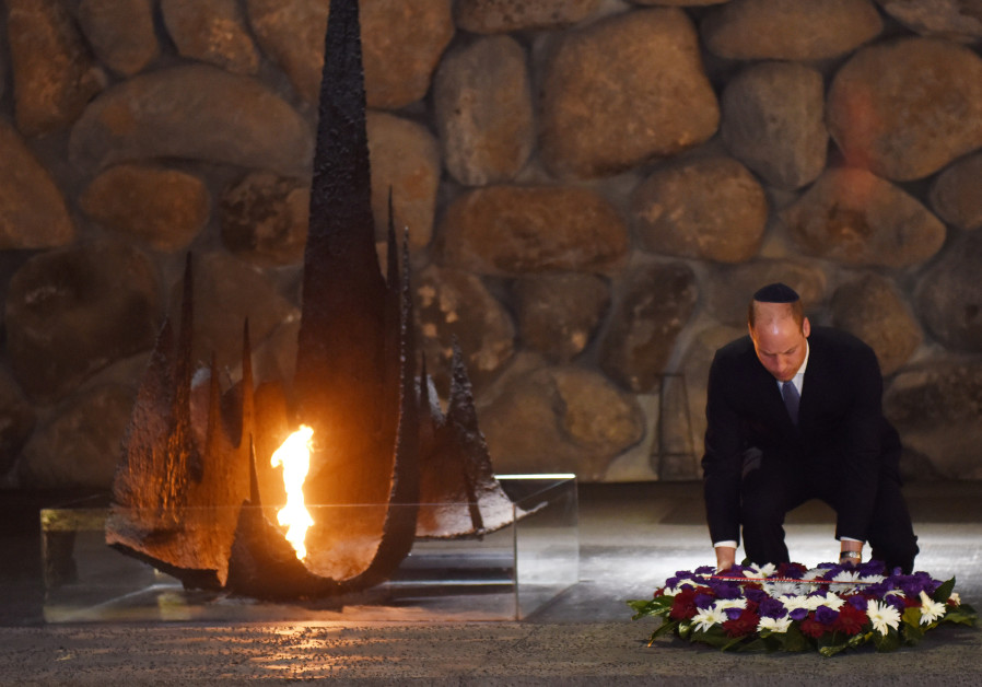 Britain's Prince William lays a wreath during a ceremony commemorating the six million Jews killed b