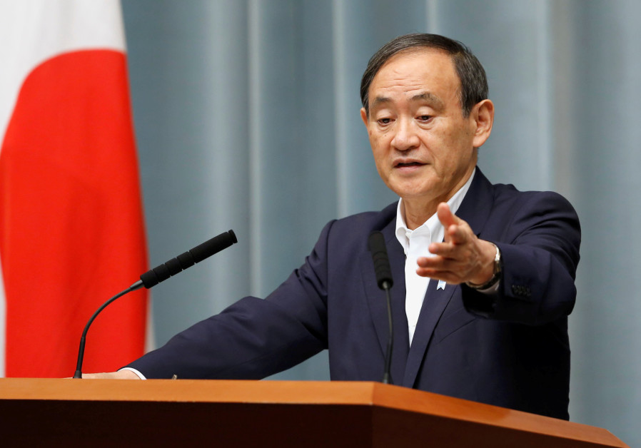 Japan's Chief Cabinet Secretary Yoshihide Suga attends a news conference at Prime Minister Shinzo Ab