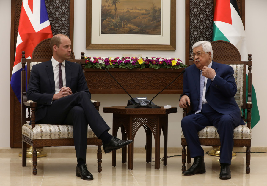 Palestinian President Mahmoud Abbas gestures during his meeting with Britain's Prince William