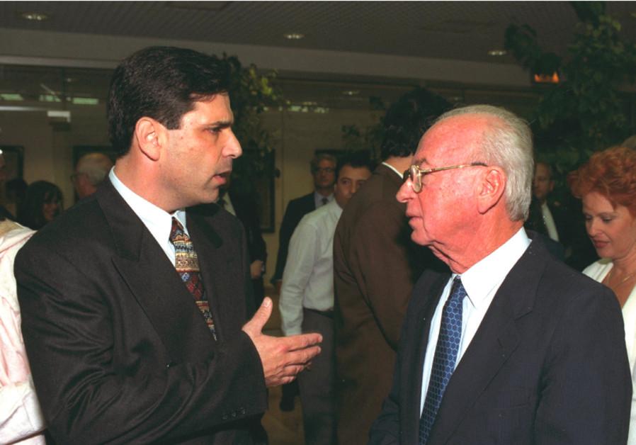 Then-energy minister Gonen Segev talks to prime minister Yitzhak Rabin