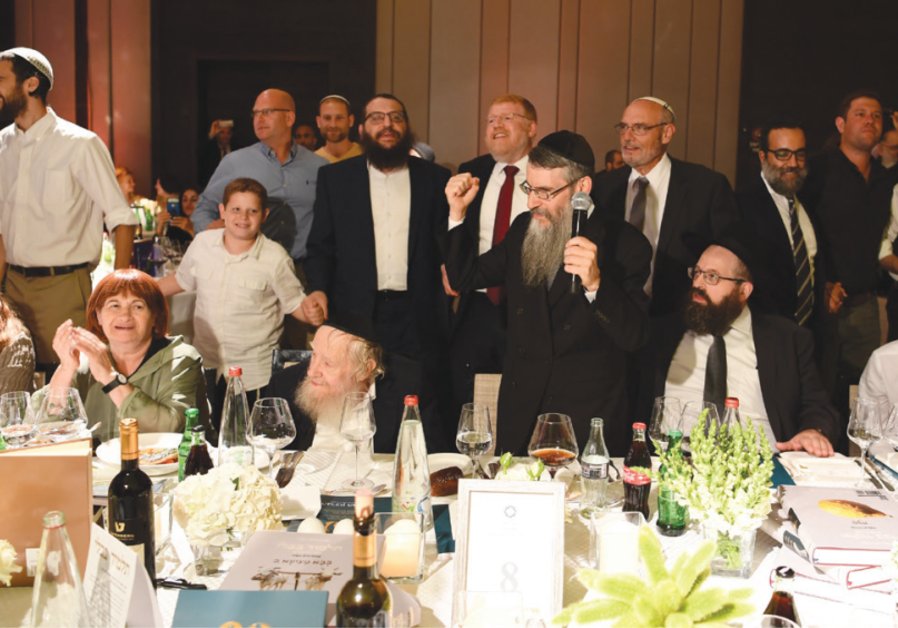 Avraham Fried sings for Rabbi Steinsaltz at the gala dinner in his honor on June 10