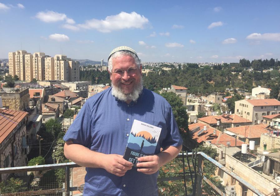 Taking things slowly in Jerusalem: Barak Hullman, holding a copy of his new memoir
