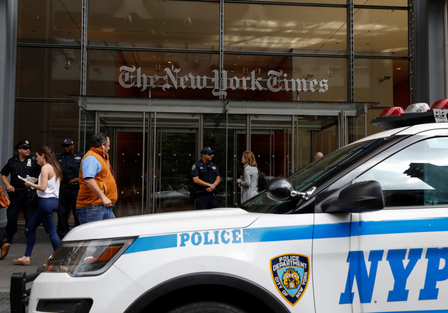 New York Police officers are seen deployed outside the New York Times building following a fatal sho