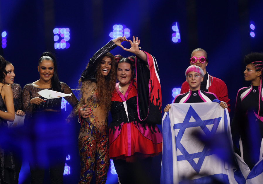 Cyprus's Eleni Foureira and Israel's Netta react after the Semi-Final 1 for Eurovision Song Contest