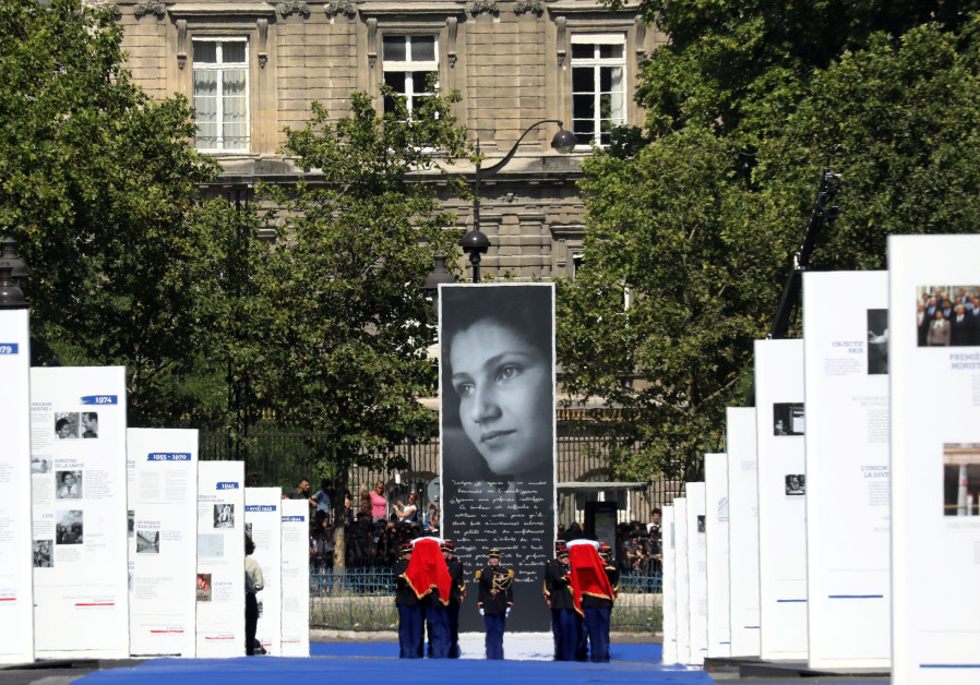 The flag-draped coffin of late Auschwitz survivor and French health minister Simone Veil