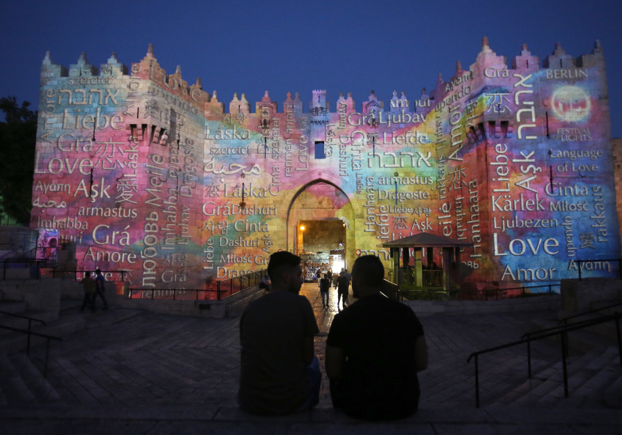 Damascus Gate, which leads to Jerusalem's Old City, is projected with the word 'love'