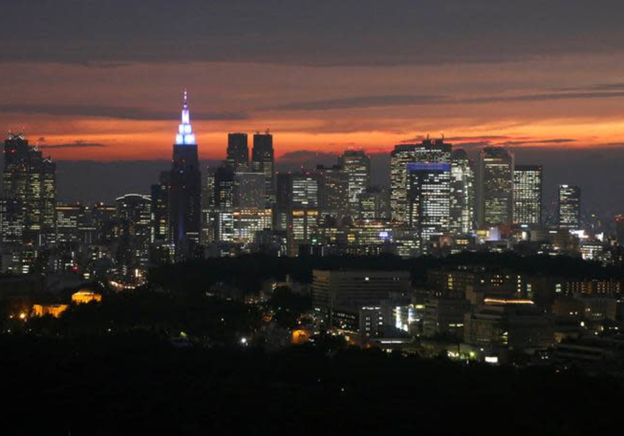 High-rise buildings are seen at the Shinjuku business district during sunset in Tokyo, Japan